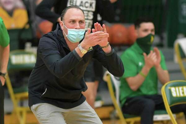 Siena College coach Carmen Maciariello cheers on his team during a Metro Atlantic Athletic Conference game against St. Peter's University at the Alumni Recreation Center on the Siena College campus in Loudonville, NY, on Saturday, Jan. 23, 2021 (Jim Franco/special to the Times Union.)