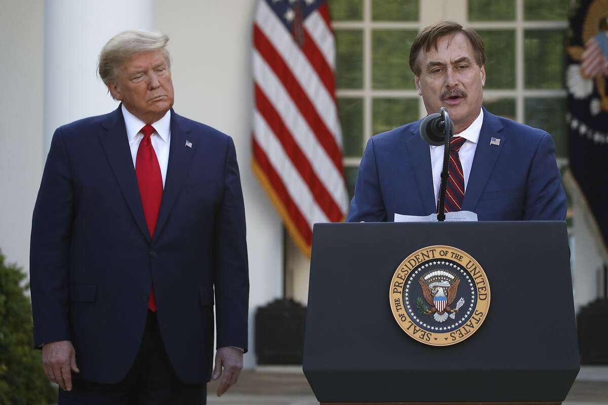 MyPillow CEO Mike Lindell speaks as President Donald Trump listens during a briefing about the coronavirus in the Rose Garden of the White House in Washington, March 30, 2020.