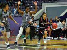 Lamar senior guard Jadyn Pimentel tries to avoid SFA defenders during a loss to the Lumberjacks Saturday in Nacogdoches.