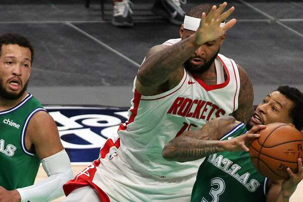 Trey Burke #3 of the Dallas Mavericks controls the ball against DeMarcus Cousins #15 of the Houston Rockets in the second quarter at American Airlines Center on January 23, 2021 in Dallas, Texas. (Photo by Ronald Martinez/Getty Images)