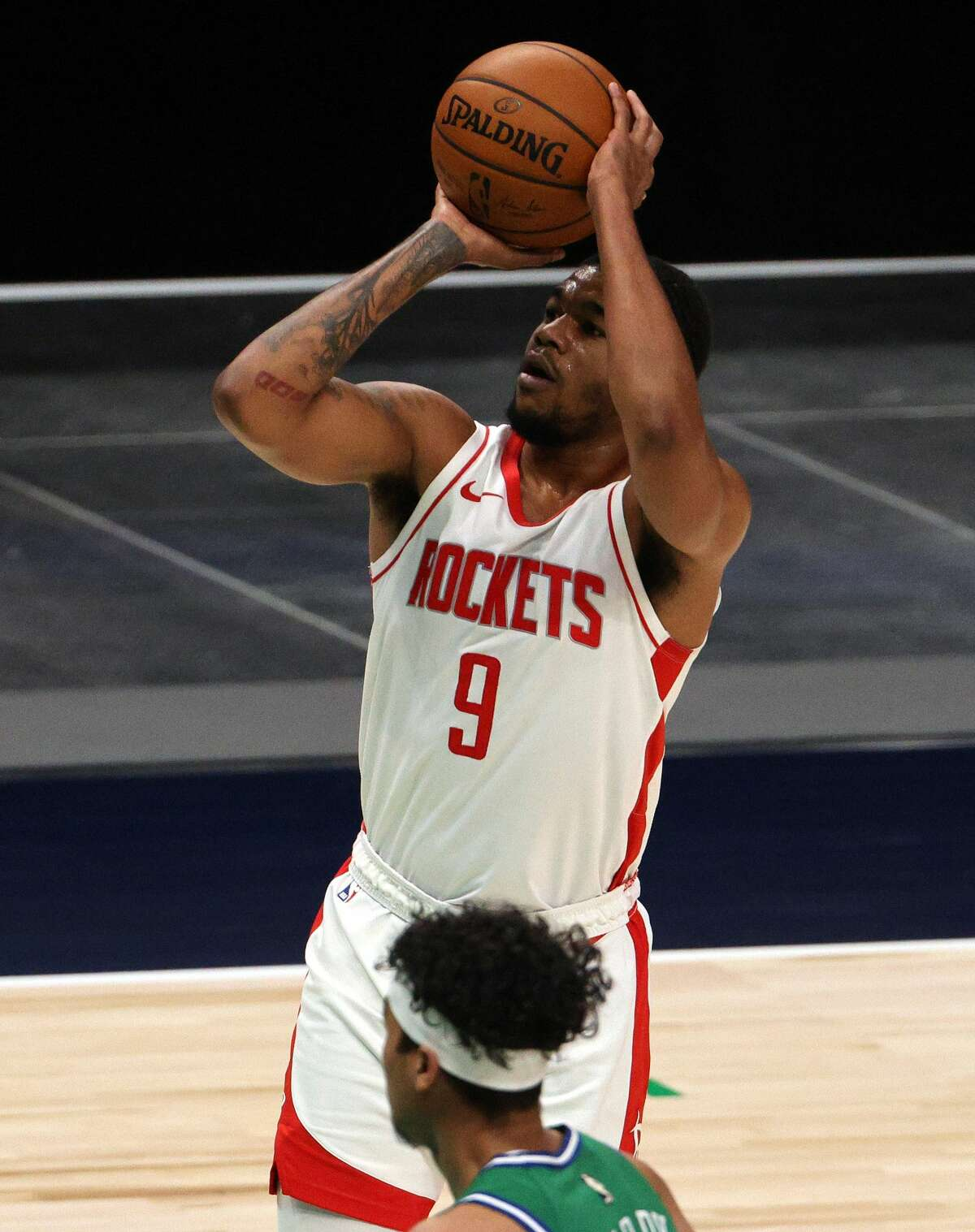 DALLAS, TEXAS - JANUARY 23: Mason Jones #9 of the Houston Rockets takes a shot against the Dallas Mavericks in the fourth quarter at American Airlines Center on January 23, 2021 in Dallas, Texas. NOTE TO USER: User expressly acknowledges and agrees that, by downloading and/or using this Photograph, User is consenting to the terms and conditions of the Getty Images License Agreement. (Photo by Ronald Martinez/Getty Images)