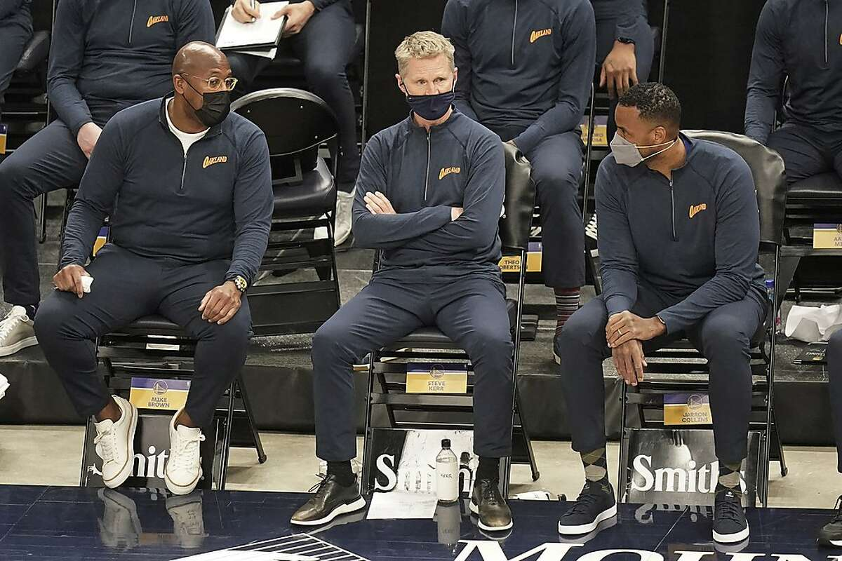 Golden State Warriors head coach Steve Kerr, center, looks on in the second half during an NBA basketball game against the Utah Jazz, Saturday, Jan. 23, 2021, in Salt Lake City. (AP Photo/Rick Bowmer)