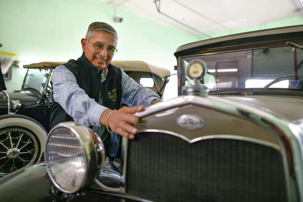 Johnny Guerra, owner of A & A Body Frame & Paint Shop on the East Side, admires his 1930 Ford, which is in good running condition. For more than 30 years Guerra, 85, has served on the Freeman Coliseum Community Advisory Board and is a nine-year member of the Equestrian Order of the Holy Sepulchre of Jerusalem