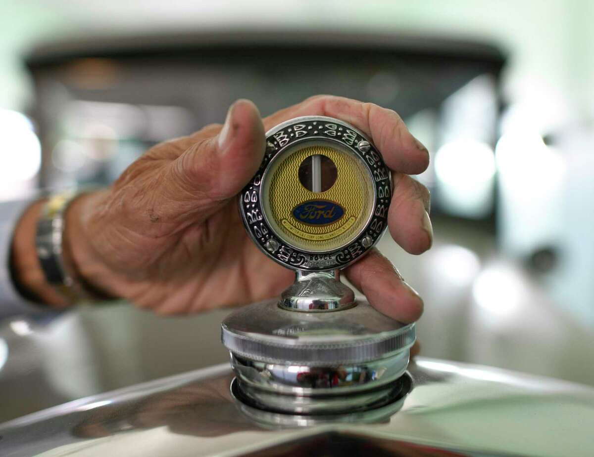 Johnny Guerra, owner of A & A Body Frame & Paint Shop, points out the hood ornament on his 1930 Ford, which is in good running order. For more than 30 years Guerra, 85, has served on the Freeman Coliseum Community Advisory Board and is a nine-year member of the Equestrian Order of the Holy Sepulchre of Jerusalem, one of the Catholic Church's highest honors.
