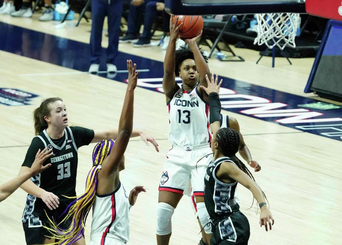 Connecticut guard Christyn Williams (13) shoots against Georgetown in the second half of an NCAA college basketball game Saturday, Jan. 23, 2021, in Storrs, Conn. (David Butler II/Pool Photo via AP)