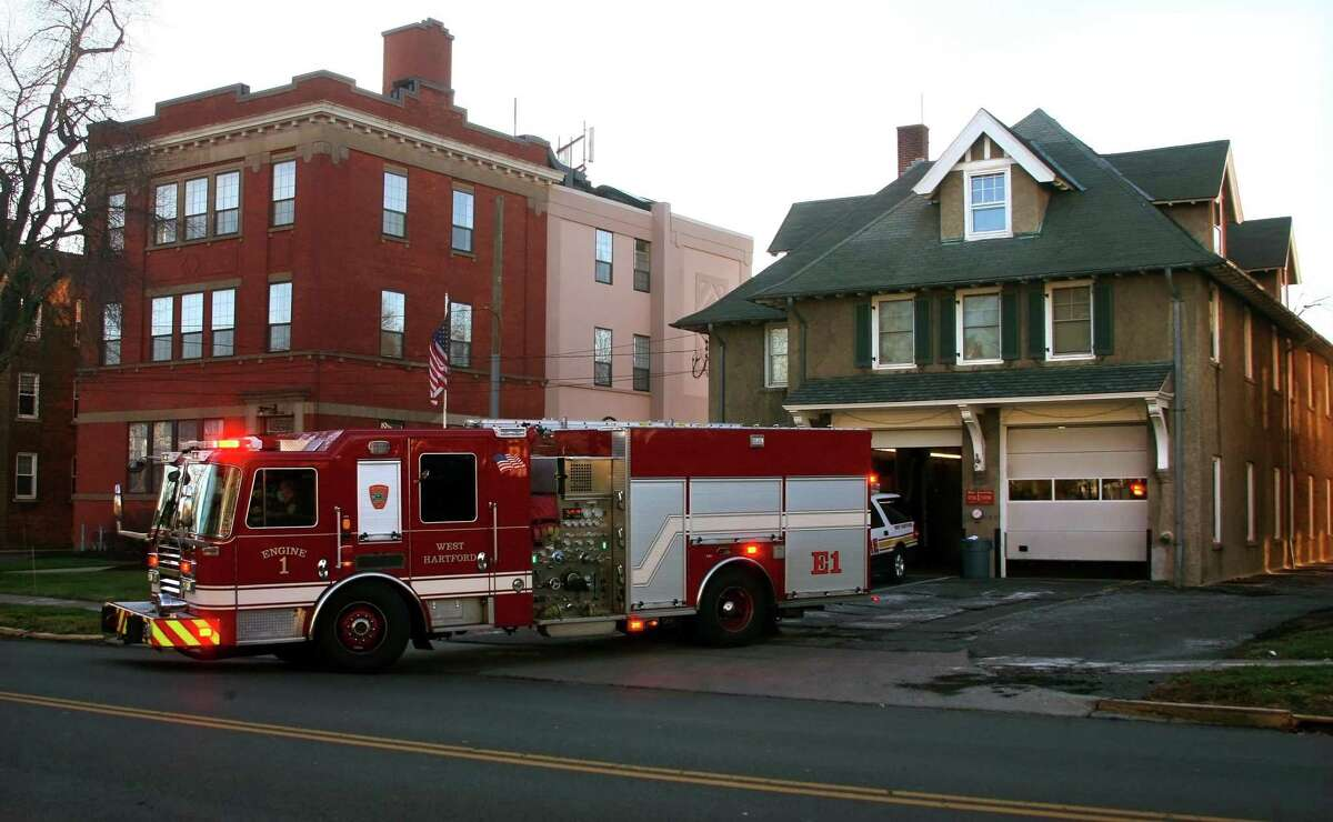 A fire engine leaves for a call from West Hartford Fire Station No. 1 in West Hartford, Conn., on Thursday Jan. 7, 2020.