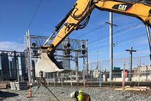 Installing concrete ties at a trackbed in Harold Interlocking on Jan. 6, 2021