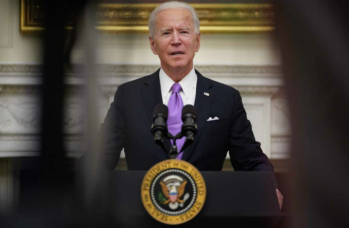 President Joe Biden speaks about the Covid-19 response before signing executive orders in the State Dining Room of the White House in Washington, DC, on January 21, 2021.