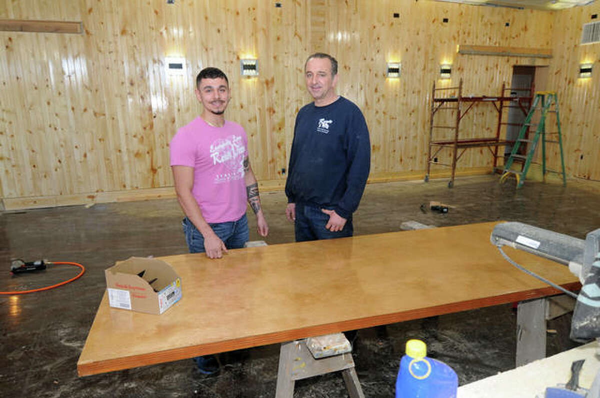 Pietro and Reno Lentini in the new banquet hall under construction at Reno's Pizza in Carlinville. The restaurant started adding the room during the COVID shutdown. Reno's plans to reopen Friday, Jan. 29.