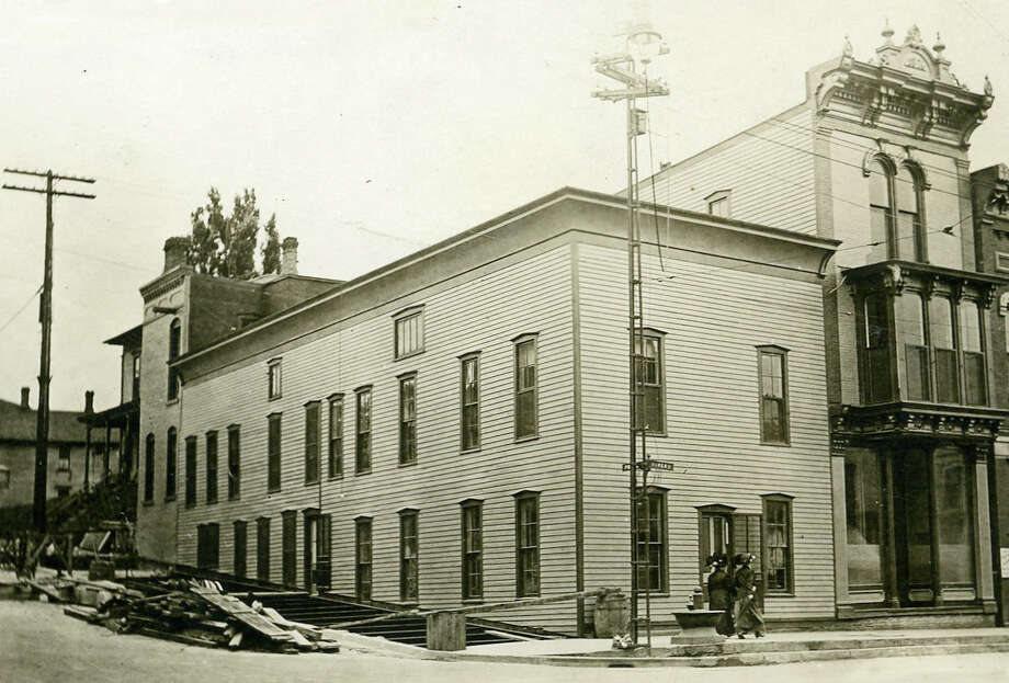 The Emeline Bath Company was formerly located on the corner of River and Poplar Street. The bathhouse occupied a portion of the building closest to the corner. The building located adjacent to that was the office and residence of Charles Ruggles. Today, the Vogue Theatre stands on the same corner where both buildings were once situated. Photo: Manistee County Historical Museum Photo