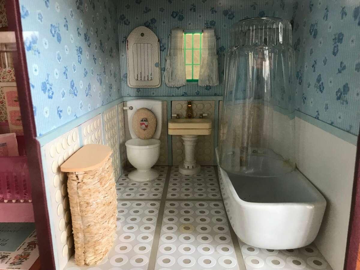 Bathroom scene by Joan Steiner