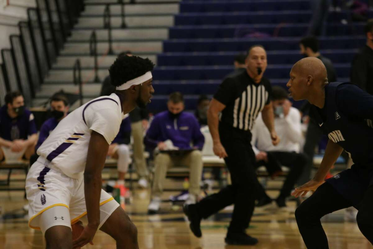 UAlbany point guard Jamel Horton, left, looks for room against New Hampshire defender New Hampshire's Marque in an America East basketball game Sunday, Jan. 24, 2021, at Lundholm Gymnasium in Durham, N.H. (Jack Bouchard/UNH athletics)