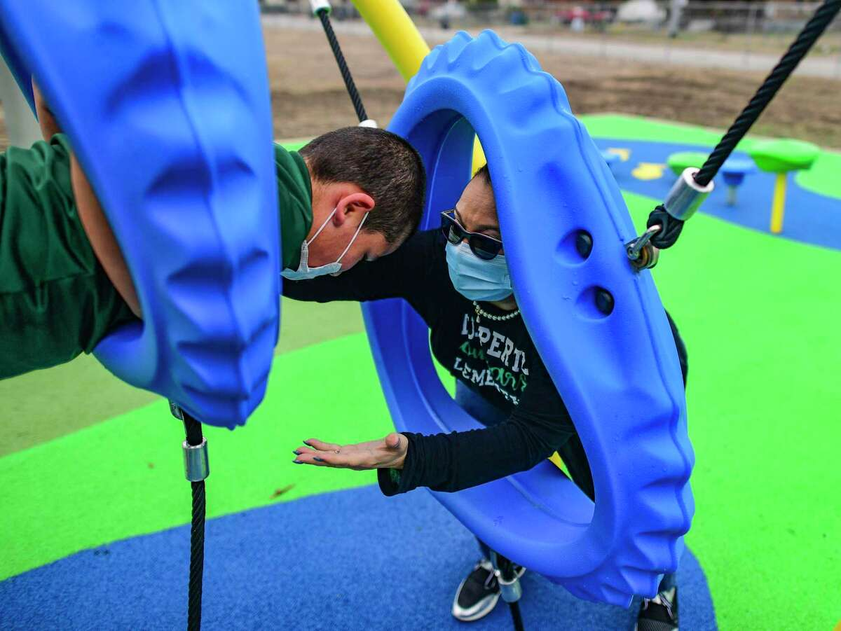 Principal Linda Rios-Garcia helps student Kobe Salazar as he explores the new ninja-style playground at Huppertz Elementary School on Thursday, Jan. 21, 2021. The playground was funded through a Texas Education Agency grant.