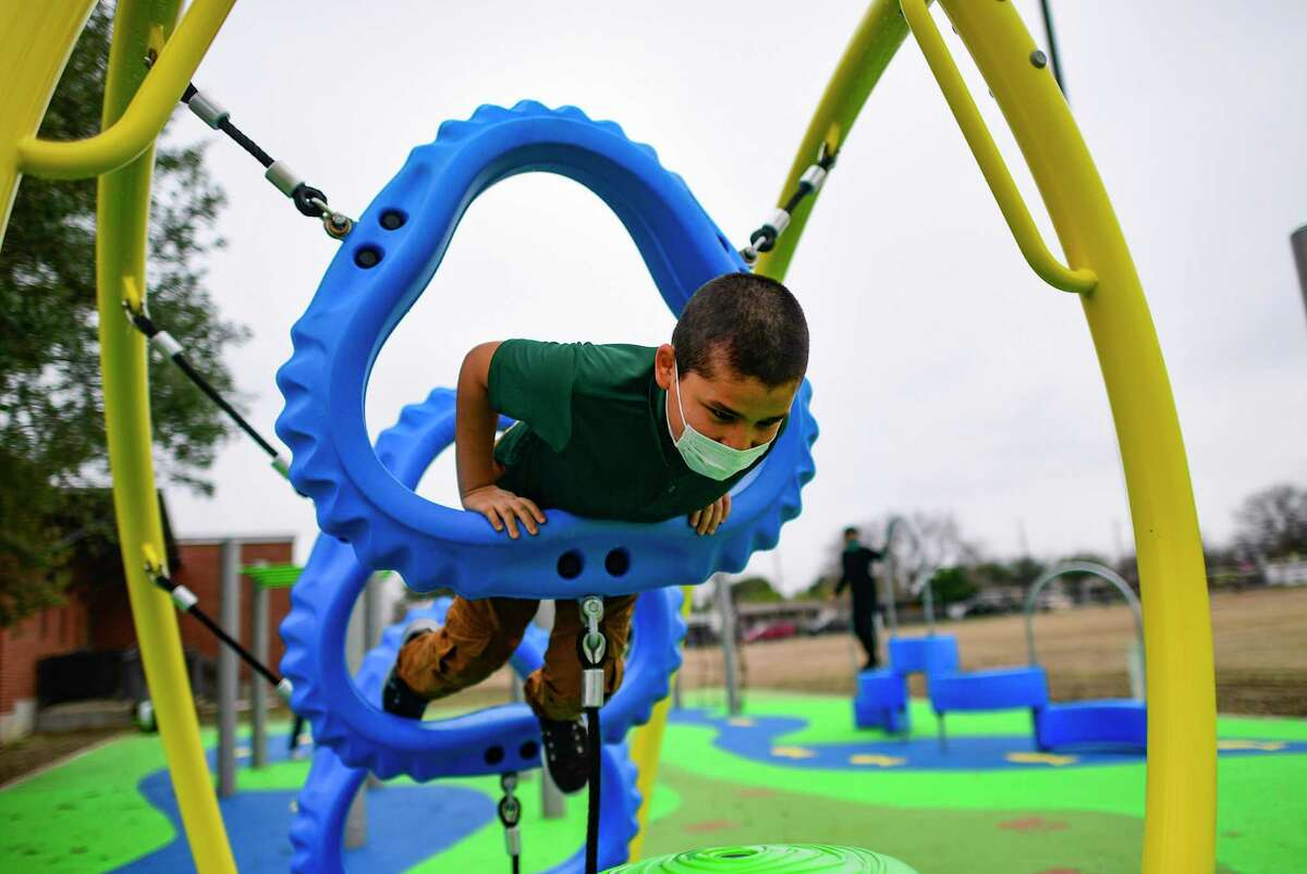 Student Kobe Salazar enjoys the new playground at Huppertz Elementary School on Thursday.