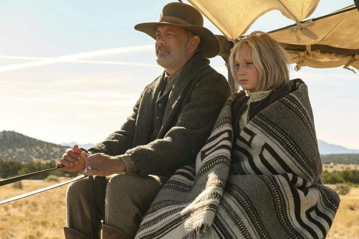 Tom Hanks, left, and Helena Zengel appear in a scene from