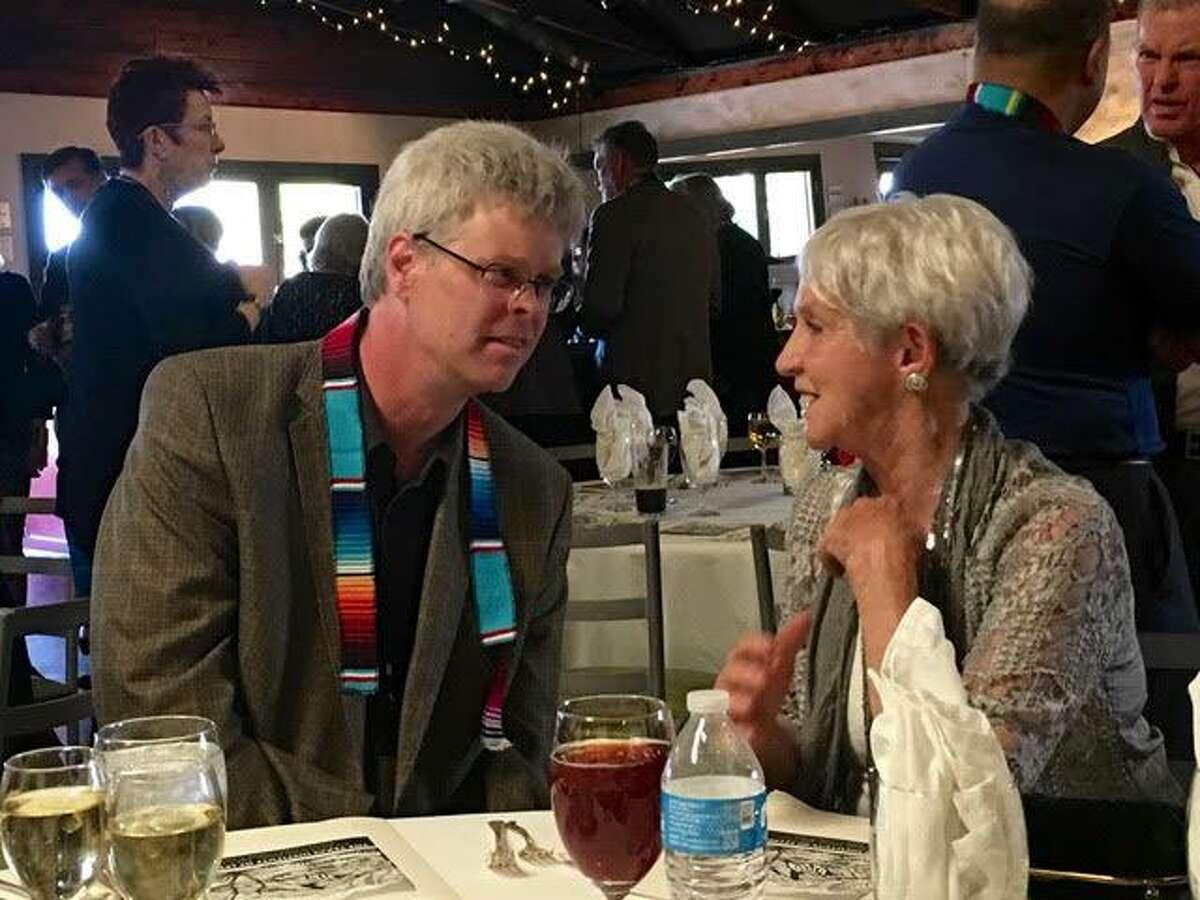 Novelist Paulette Jiles, pictured here with Texas Institute of Letters president Steve Davis, received TIL's Jesse H. Jones Award for Fiction in 2017, for her novel