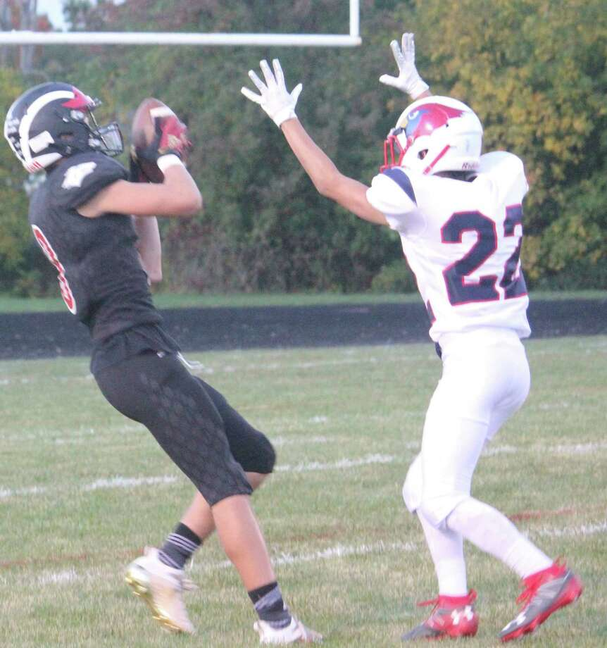 Reed City's Seth Jackson (left) hauls in a touchdown pass during the regular season against Big Rapids. (Pioneer file photo)