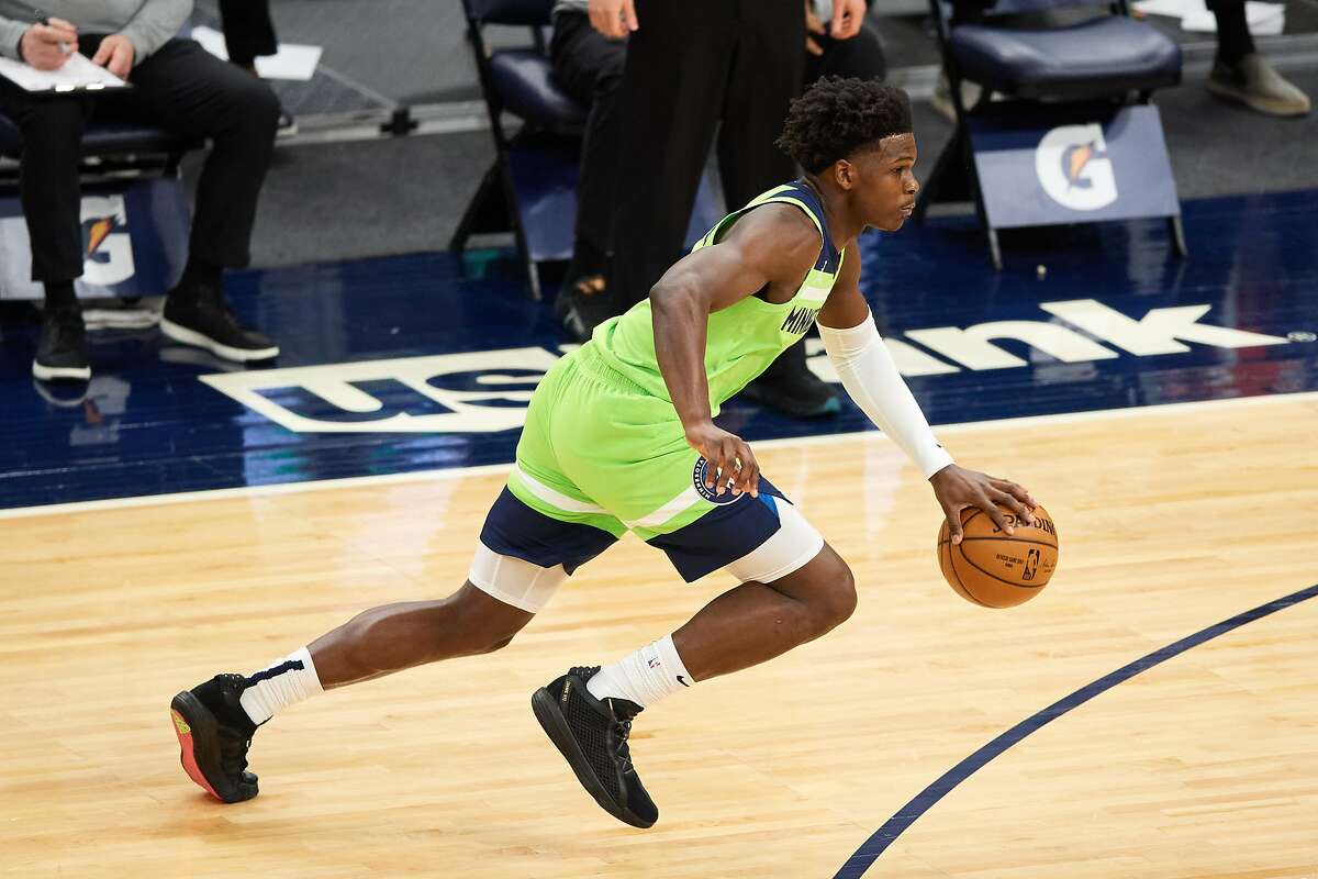 MINNEAPOLIS, MINNESOTA - JANUARY 23: Anthony Edwards #1 of the Minnesota Timberwolves drives to the basket against the New Orleans Pelicans during the second quarter of the game at Target Center on January 23, 2021 in Minneapolis, Minnesota. NOTE TO USER: User expressly acknowledges and agrees that, by downloading and or using this Photograph, user is consenting to the terms and conditions of the Getty Images License Agreement (Photo by Hannah Foslien/Getty Images)