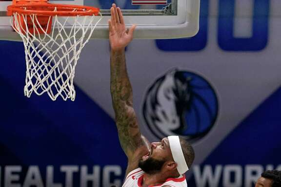 DeMarcus Cousins was effective in the paint and from long range in putting up 28 points in the Rockets' 133-108 victory at Dallas on Saturday night.