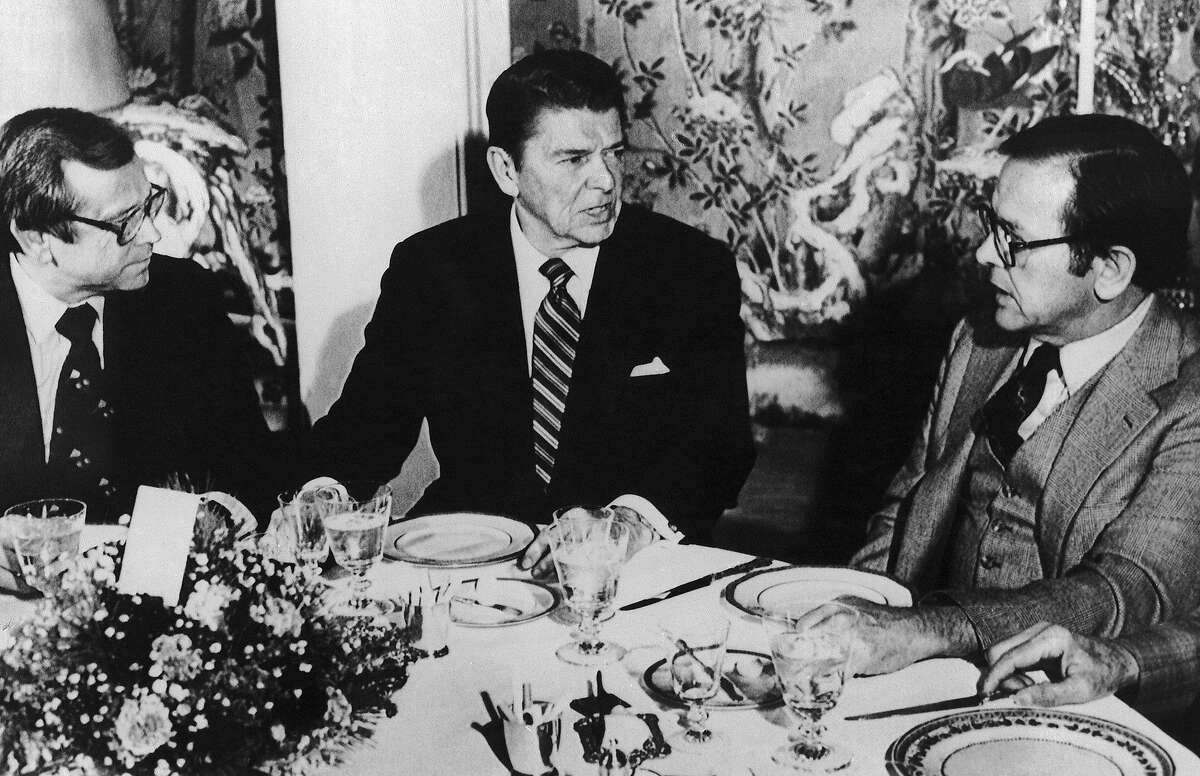 FILE - This Dec. 13, 1980 file photo shows President-elect Ronald Reagan, center, talking with Sen. Ted Stevens, R-Alaska, right, and Sen. Howard Baker, R-Tenn. during a luncheon at Blair House in Washington. . Baker, who asked what President Richard Nixon knew about Watergate, has died. He was 88. Baker, a Republican, served 18 years in the Senate. He earned the respect of Republicans and Democrats alike and rose to the post of majority leader. He served as White House chief of staff at the end of the Reagan administration and was U.S. ambassador to Japan during President George W. Bush's first term. (AP Photo/Bob Daugherty, File)