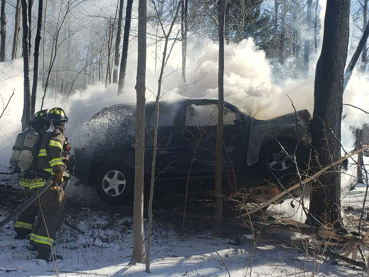 The Norfolk Volunteer Fire Department said a tractor-trailer driver witnessed the accident and pulled the driver from a vehicle seconds before the driver compartment was engulfed in flames.