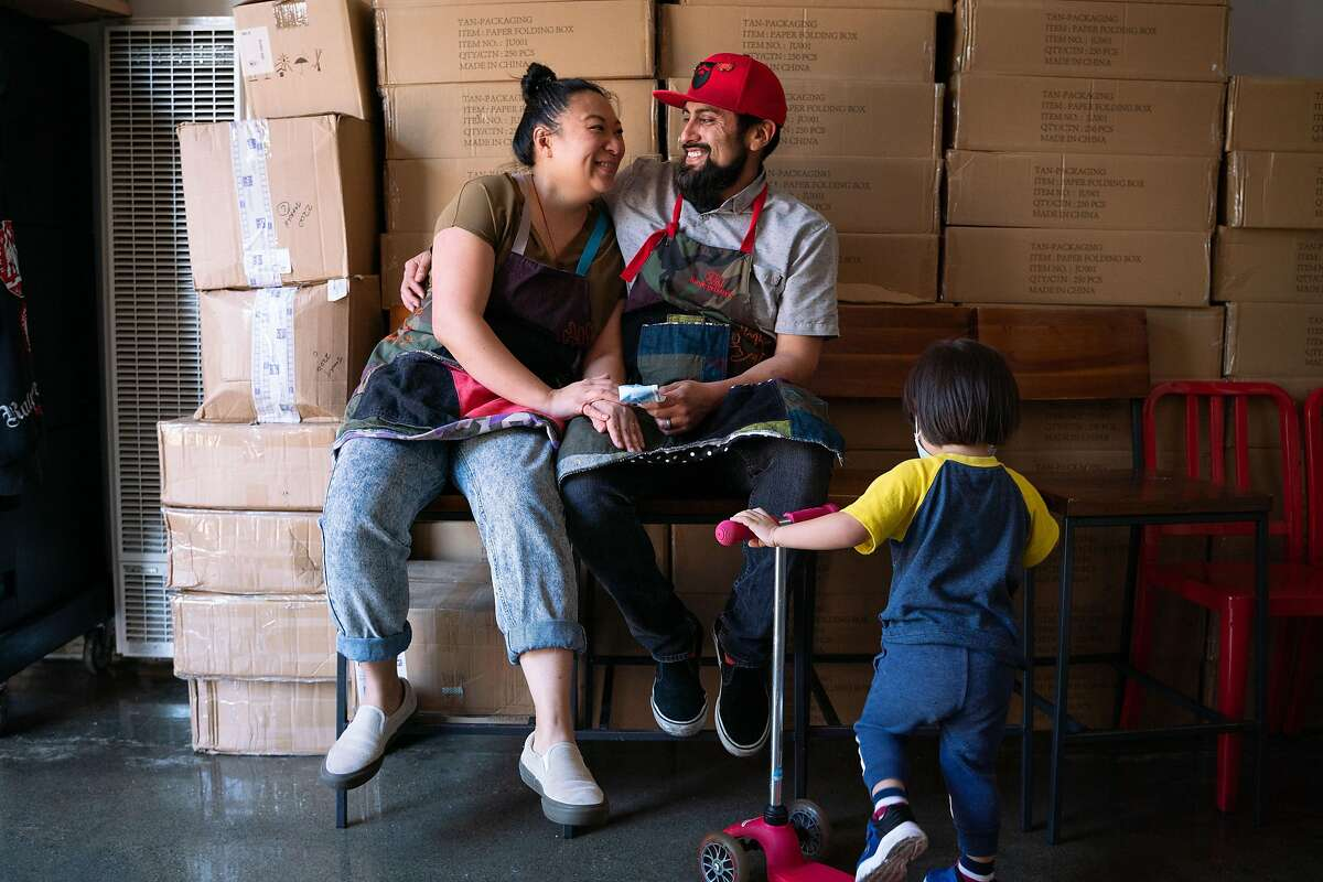 Kim Truong, and her husband, Jorge Islas, in Frank Grizzly's Kitchen in San Francisco, with son Oden Islas Truong, 2, playing nearby.