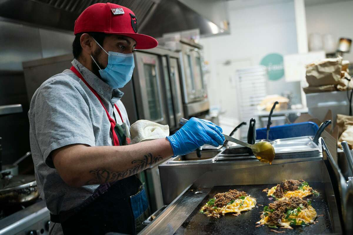 Jorge Islas prepares an order of the popular quesabirrias at Frank Grizzly's Kitchen in San Francisco.