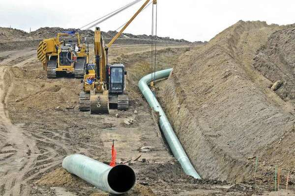 Heavy equipment is used in 2016 to place sections of the Dakota Access pipeline, which cuts through Pike, Morgan, Brown and Scott counties in Illinois.