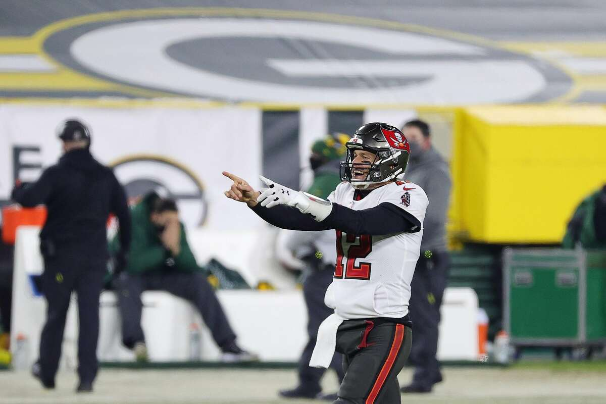 Tom Brady #12 of the Tampa Bay Buccaneers celebrates in the final seconds of their 31 to 26 win over the Green Bay Packers during the NFC Championship game at Lambeau Field on January 24, 2021 in Green Bay, Wisconsin.