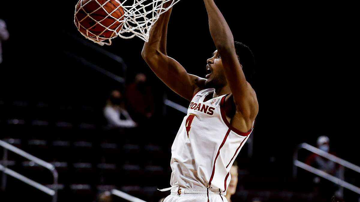 Southern California forward Evan Mobley (4) dunks during an NCAA college basketball game between Southern California and Washington State Saturday, Jan. 16, 2021, in Los Angeles. (AP Photo/Ringo H.W. Chiu)