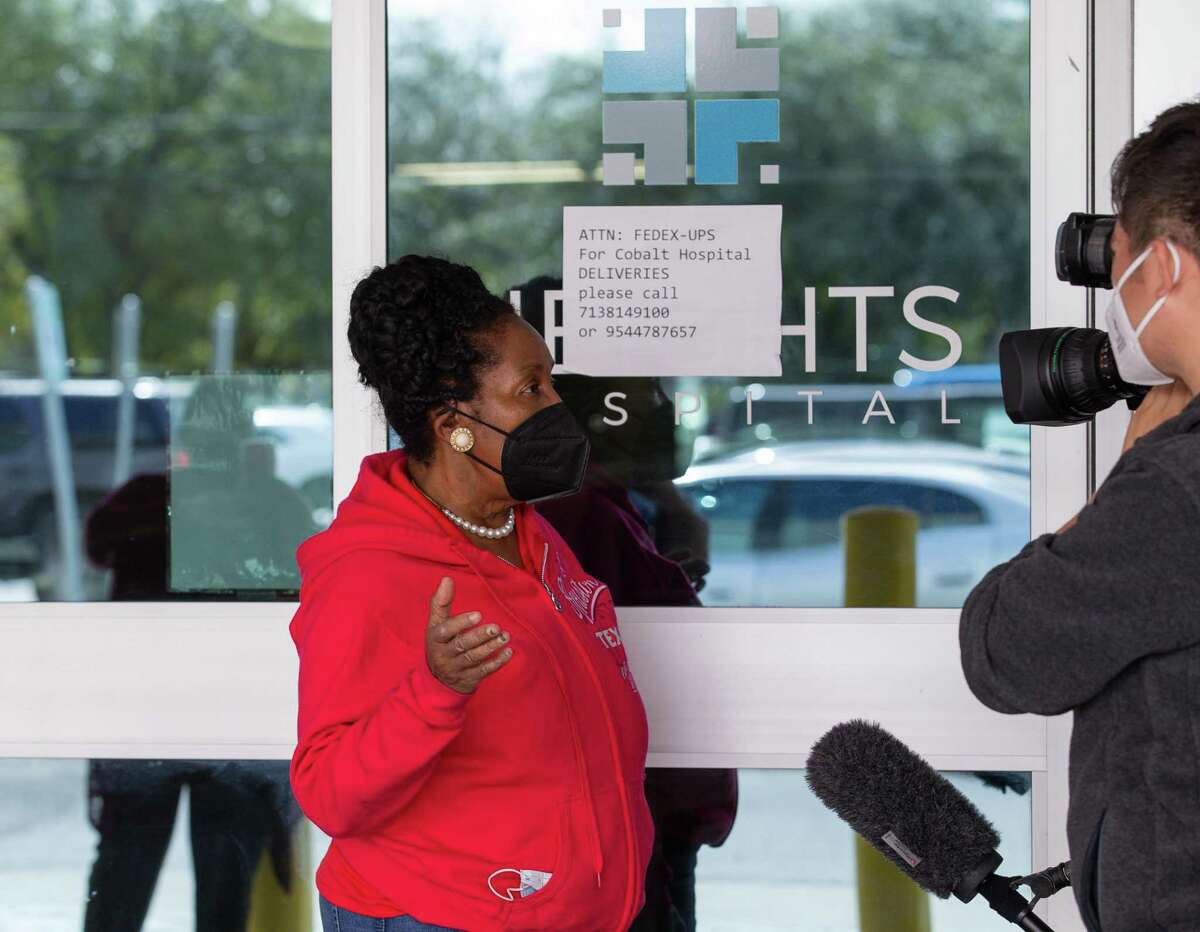 U.S. Representative Sheila Jackson Lee talks with reporters outside the Heights Hospital on Monday, Jan. 18, 2021, in Houston. The hospital filed for bankruptcy, leaving medical staff and patients locked out without any notice.
