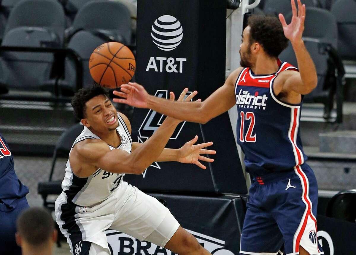 Keldon Johnson #3 of the San Antonio Spurs #3 battles Jerome Washington #12 of the Washington Wizards. Wizards v Spurs at AT&T Center on Sunday, Jan. 24, 2021
