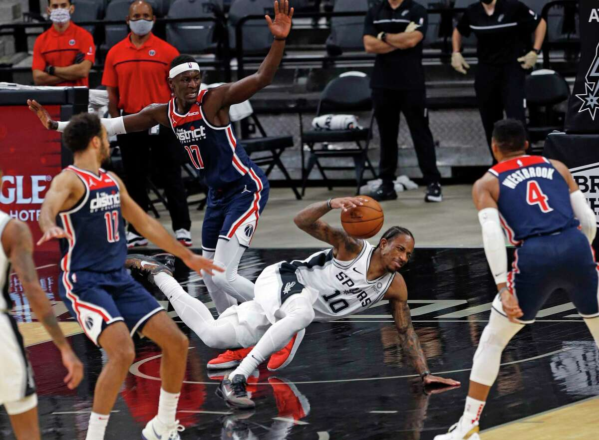 DeMar DeRozan #10 of the San Antonio Spurs hits the court after being fouled.Wizards v Spurs at AT&T Center on Sunday, Jan. 24, 2021