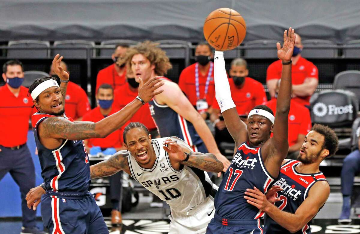 DeMar DeRozan #10 of the San Antonio Spurs fights for a loose ball with a host of Washington Wizards. Wizards v Spurs at AT&T Center on Sunday, Jan. 24, 2021