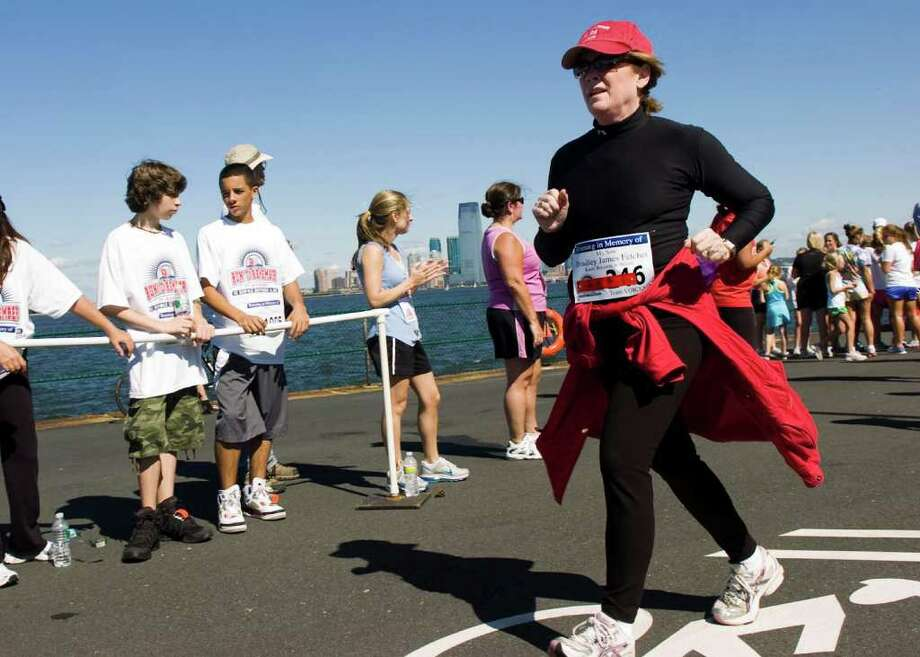 Mary Fetchet races in the 2nd Annual World Trade Center Run to Remember on Governor's Island in New York Harbor Sunday, September 5, 2010. The event is a charity race for 9/11 beneficiaries including Voices of September 11th which was founded by New Canaan's Mary A. Fetchet whose son, Brad, lost his life on September 11, 2001. Photo: Keelin Daly / Stamford Advocate