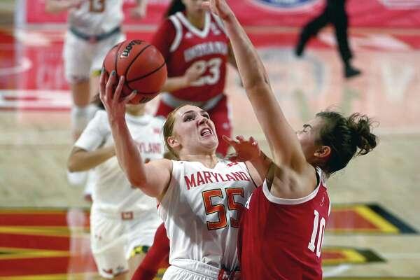 Maryland Terrapins forward Chloe Bibby (55) looks to shoot over Indiana Hoosiers forward Aleksa Gulbe (10) at Xfinity Center in College Park, Md., on Jan. 4, 2021.