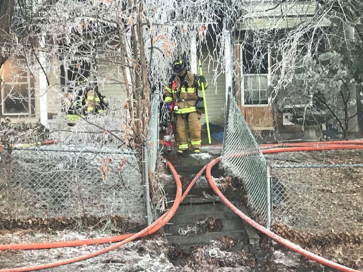 Troy firefighters battle a fire that consumed a vacant home Monday morning on Campbell Avenue. The fire destroyed the home but it does not appear that anyone was hurt, fire officials said.