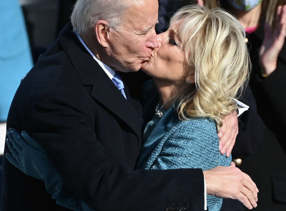 Joe Biden is embraced by his wife Jill after taking the oath of office as the 46th US President by Supreme Court Chief Justice John Roberts on January 20, 2021, at the US Capitol in Washington, DC.