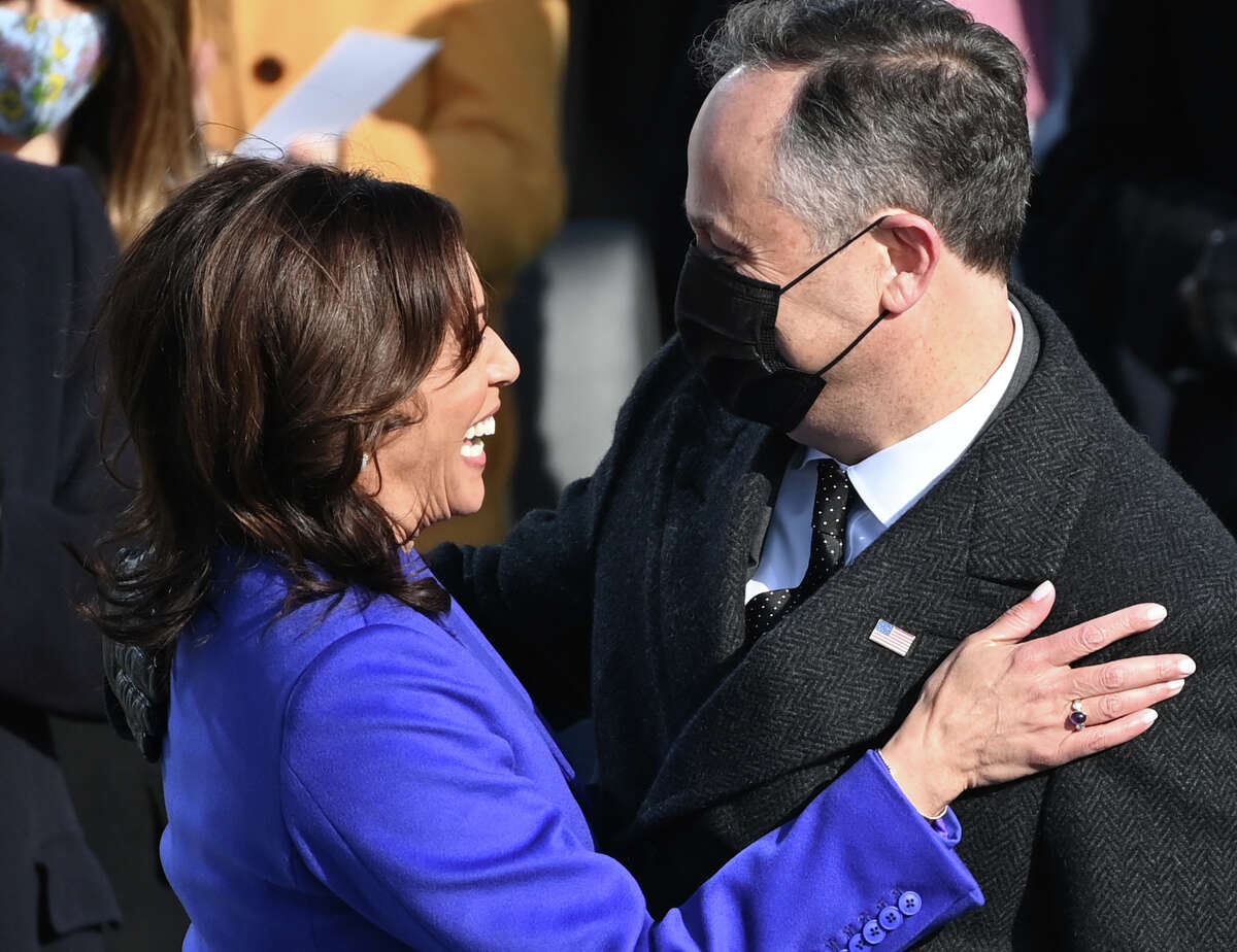 Kamala Harris is embraced by her husband Doug Emhoff after being sworn in as the 49th US Vice President by Supreme Court Justice Sonia Sotomayor on January 20, 2021, at the US Capitol in Washington, DC.