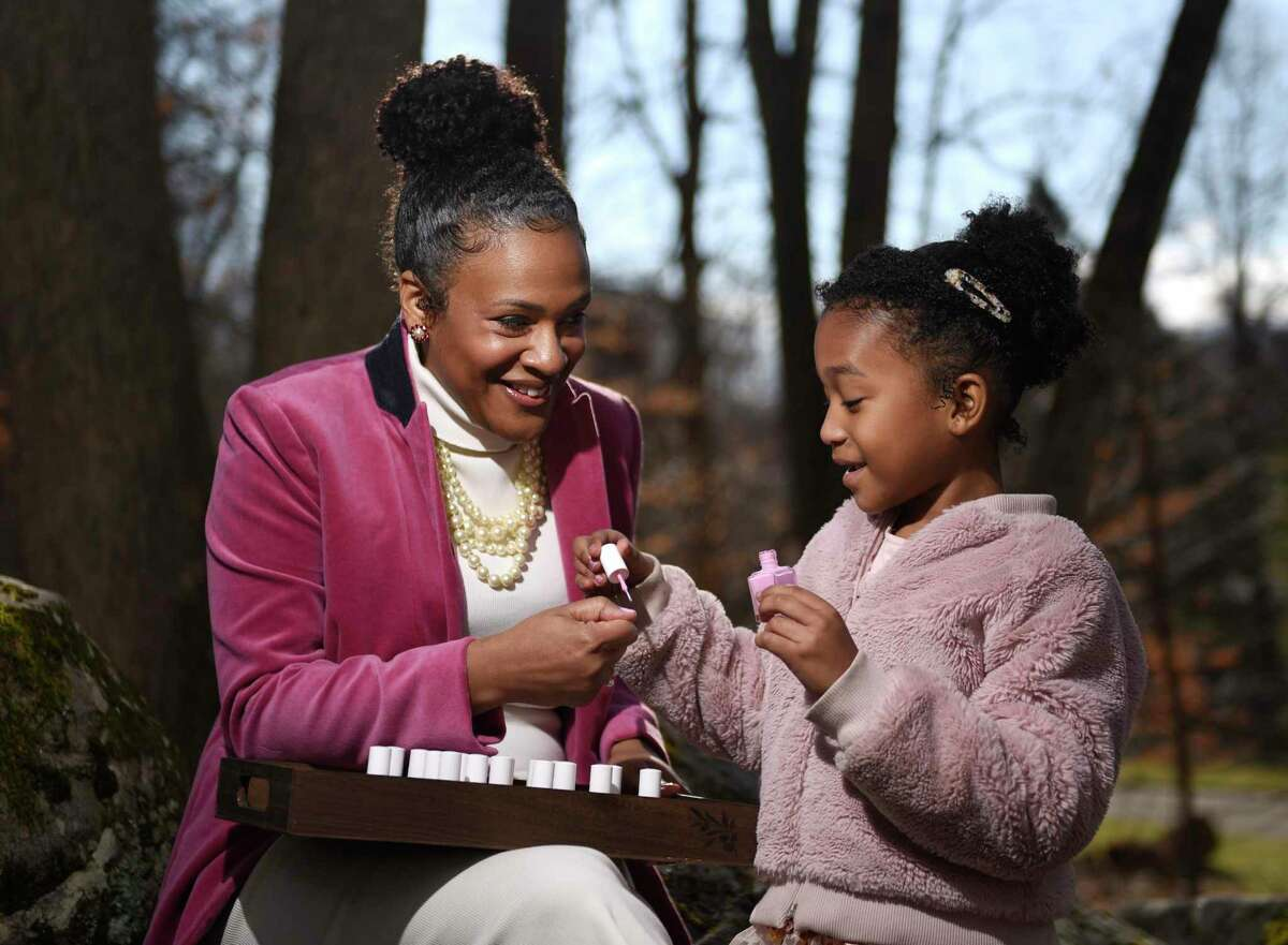 Khandice O'Kelley and her daughter, Taylor O'Kelley, 7, put on Pink Chawkulit nail polish at their home in Stamford on Jan. 20. Khandice and Taylor's routine of going to the nail salon was disrupted because of COVID-19, so the two decided to start making their own nail polish. The startup, which they've marketed as Pink Chawkulit, features toxin-free polishes and has quickly gained quite a following.