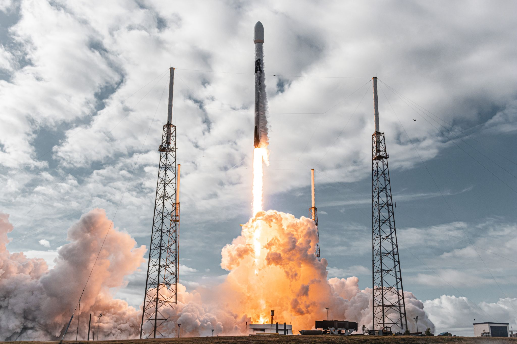 SpaceX deploys record 143 small spacecraft into orbit