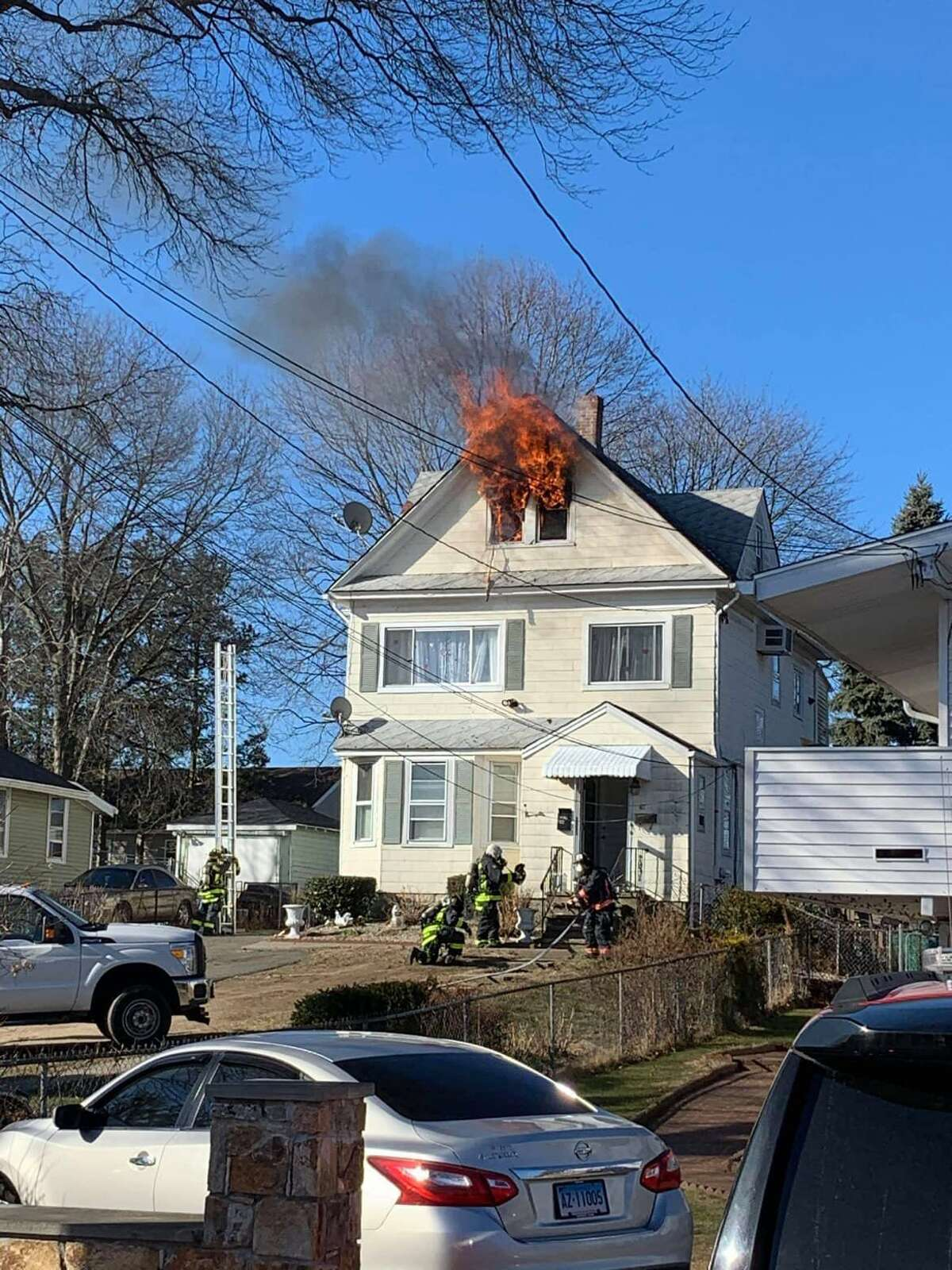 Firefighters at a Stratford, Conn., house fire on Sunday, Jan. 24, 2021.