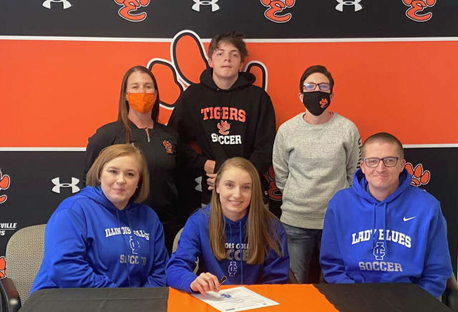 Edwardsville High School senior Riley Chitwood, seated center, will play women's college soccer at Illinois College. She is joined in the picture by her family, along with EHS coach Abby Federmann and EHS assistant coach Jackie Harlin. Photo: For The Intelligencer