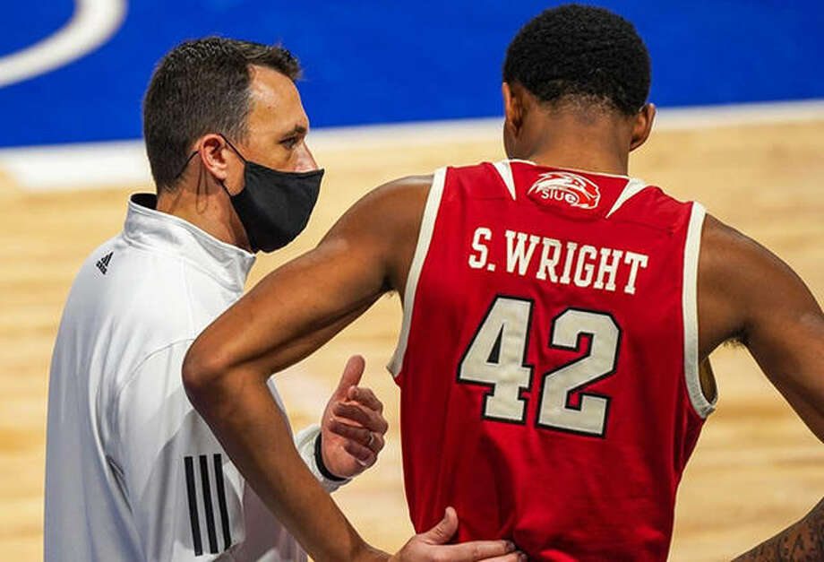 SIUE coach Brian Barone talks with the Cougars' Shamar Wright during a game earlier this season. After nine postponements, SIUE faces a busy stretch to make up games in the OVC. Photo: SIUE Athletics