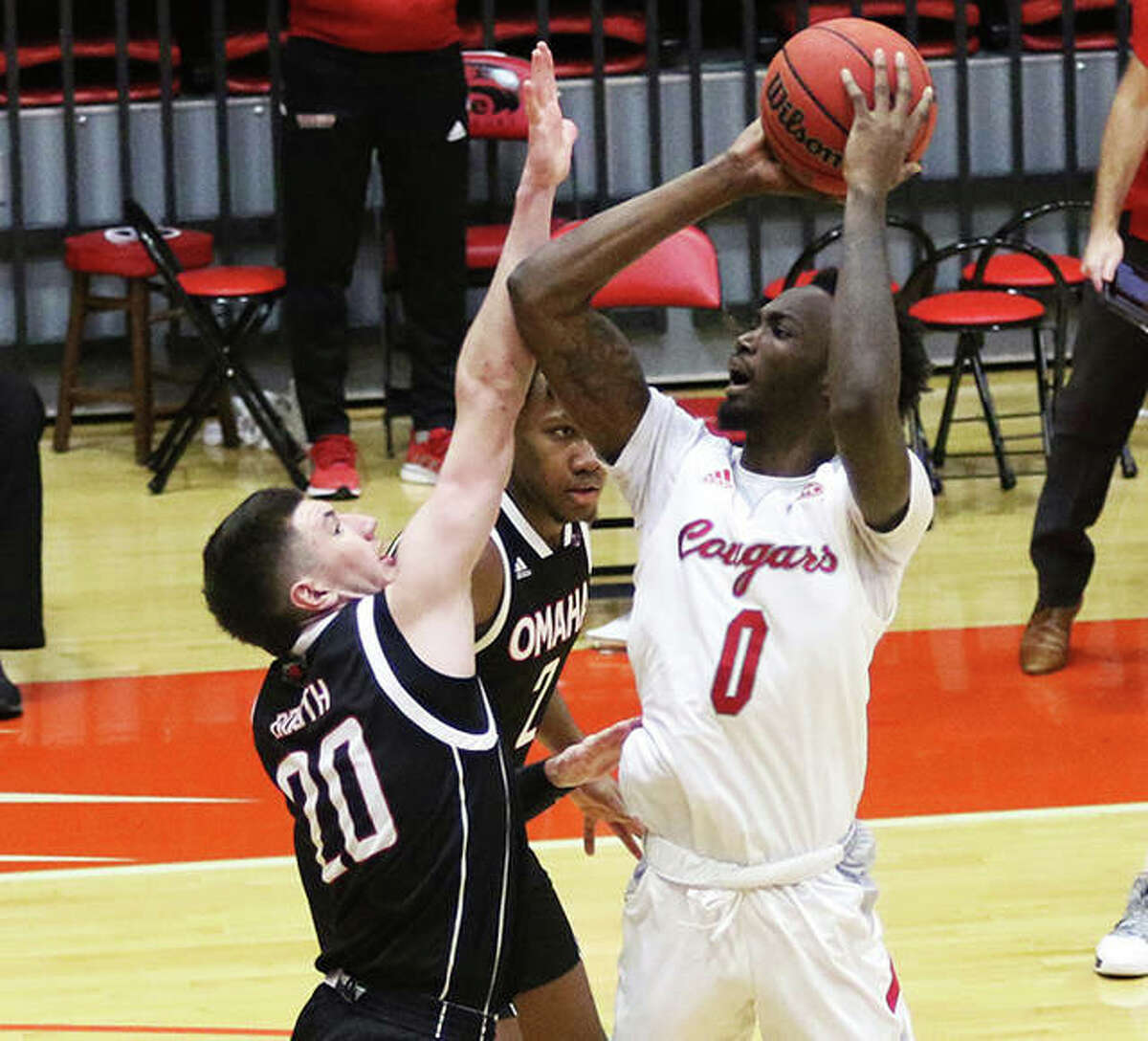 SIUE's Sidney Wilson (0) shoots over Omaha's Jadin Booth during a Dec. 5 game at First Community Arena in Edwardsville. The Cougars play the first of three road games this week Tuesday night vs. Eastern Illinois in Charleston.