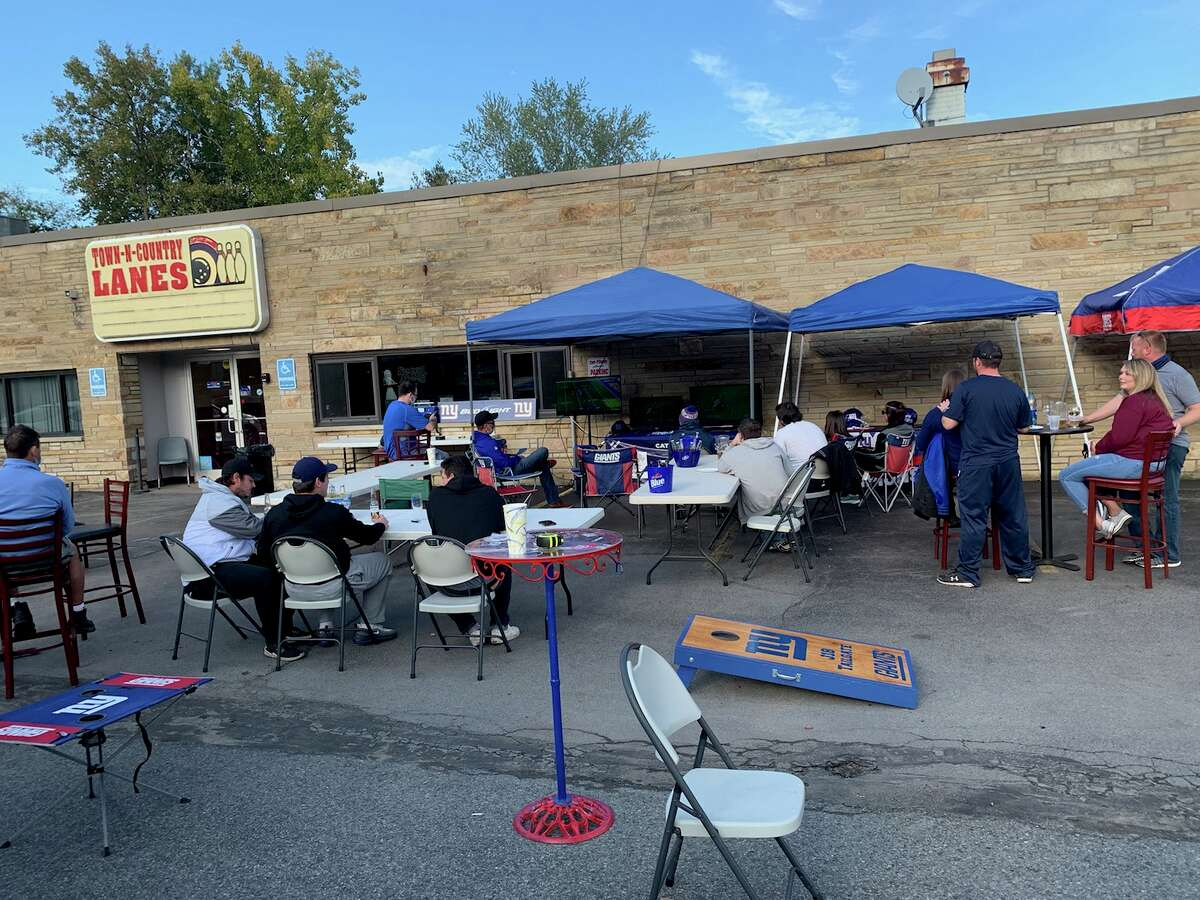"""Jeremy Hoogkamp and friends """"tailgating"""" for New York Giants' games at the Town 'N Country Lanes bowling alley in Guilderland."""