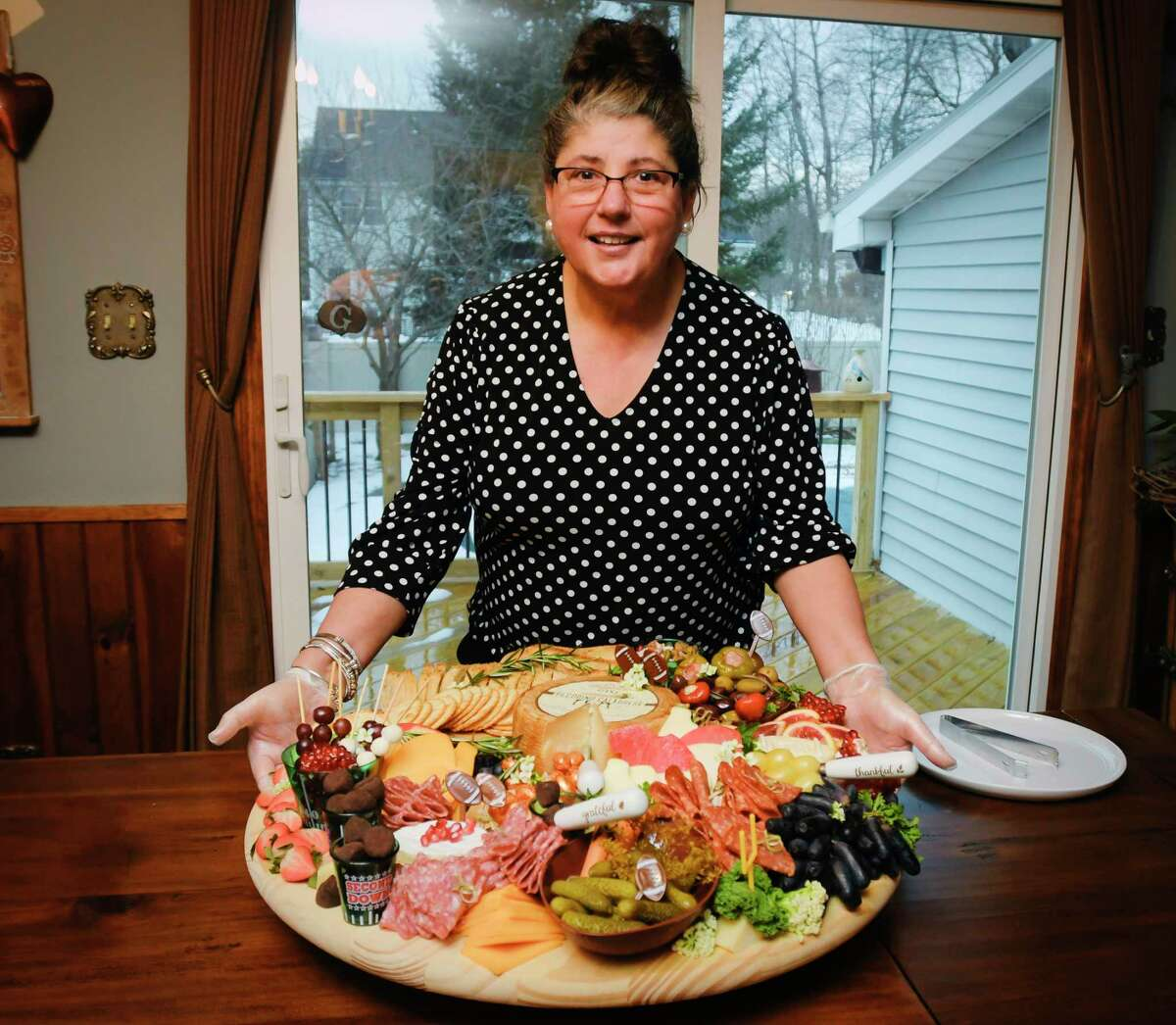 Maria Greco, owner of 518grazing, with The Man Cave grazing board she creates, on Sunday, Jan. 17, 2021, in Niskayuna, N.Y. (Paul Buckowski/Times Union)