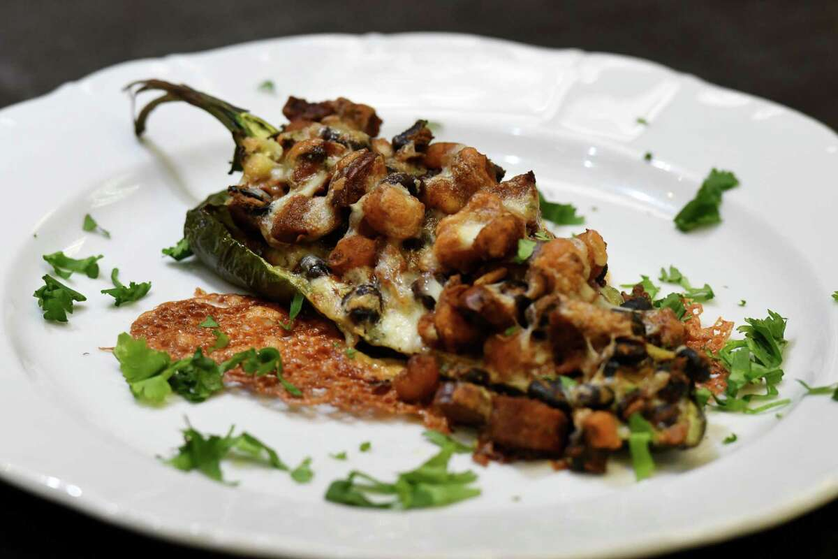 Stuffed poblano pepper with chorizo and hominy from Caroline Barrett on Tuesday, Jan. 19, 2021, at Different Drummer's Kitchen in Guilderland, N.Y. (Will Waldron/Times Union)