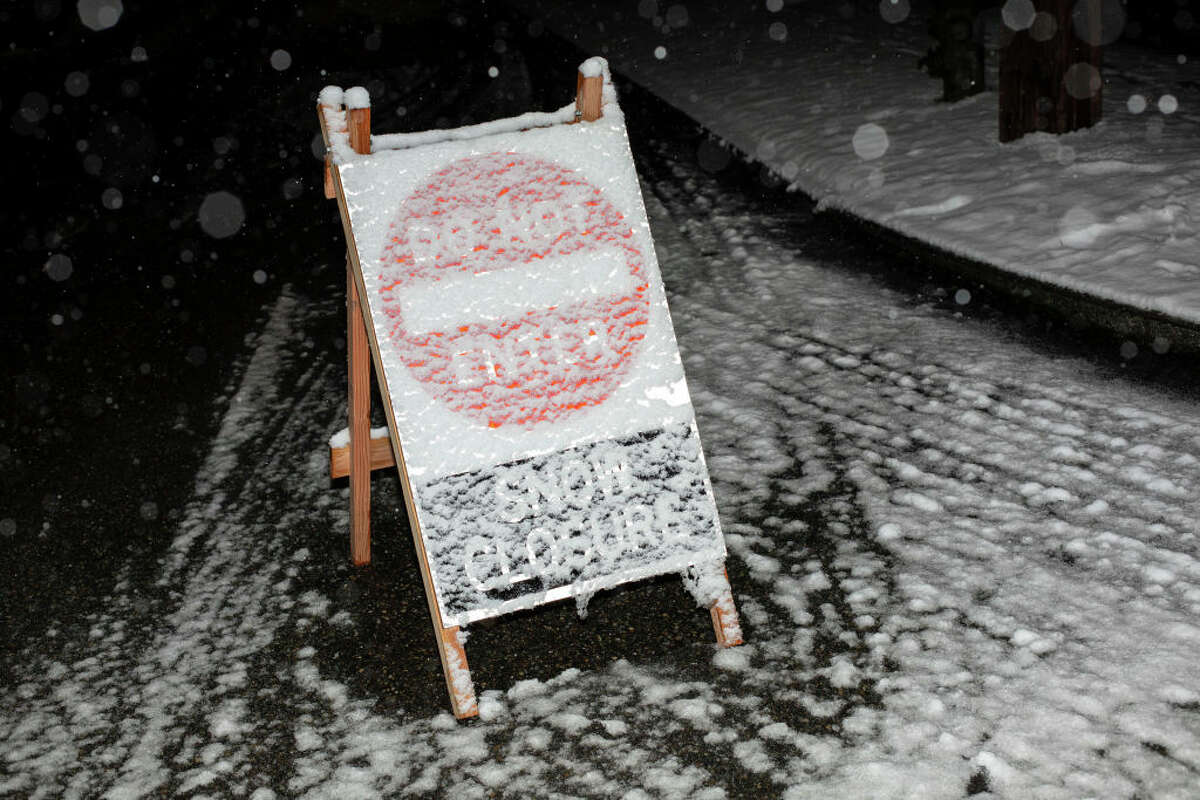 SEATTLE, WA - FEBRUARY 08: A snow closure sign is pictured blocking a road as snow falls on February 8, 2019 in Seattle, Washington. (Photo by David Ryder/Getty Images)
