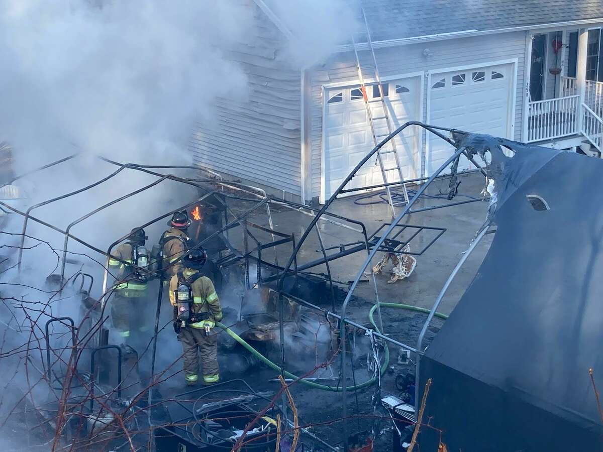 Crews at the scene of a carport fire in Beacon Falls, Conn., on Saturday, Jan. 23, 2021.